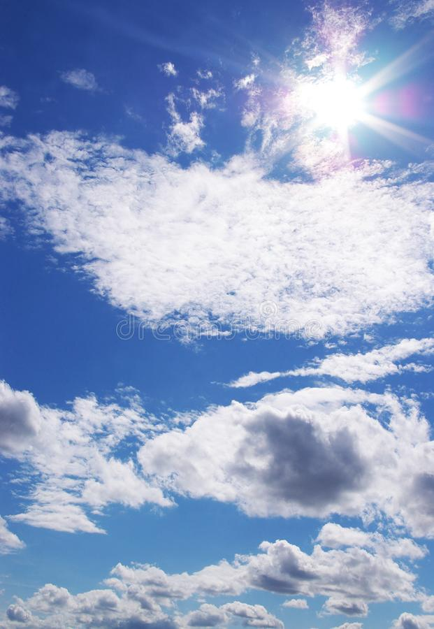 Sun and clouds in a blue sky stock photography