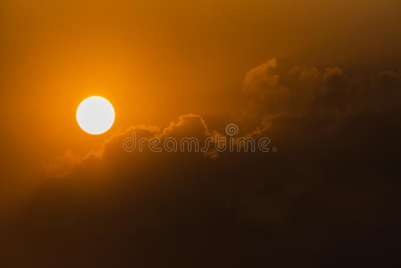 The Sun and clouds. Cloiuds approaching to hide sun royalty free stock image