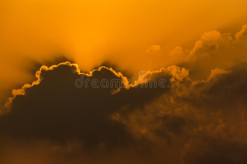 The Sun and clouds. Dark cloiuds in front of sun royalty free stock images