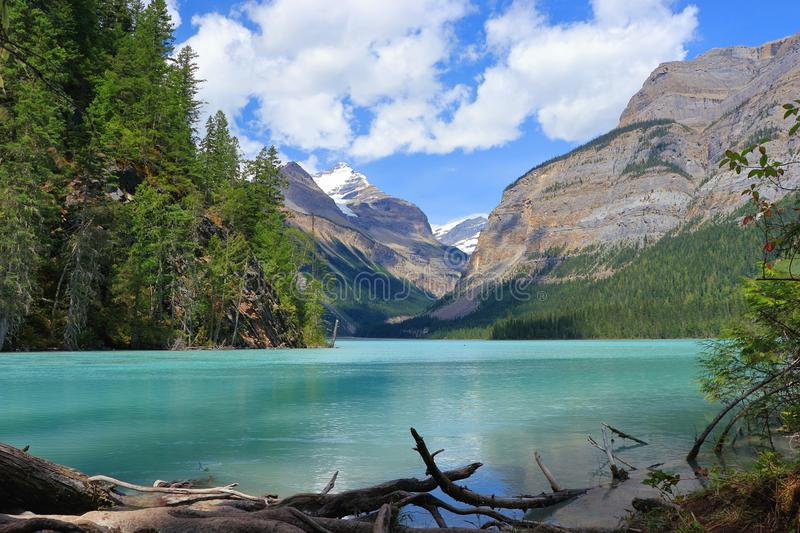 Sun and Clouds at Glacial Kinney Lake in the Canadian Rocky Mountains, Mount Robson Provincial Park, British Columbia, Canada. Turquoise glacial waters of the stock image