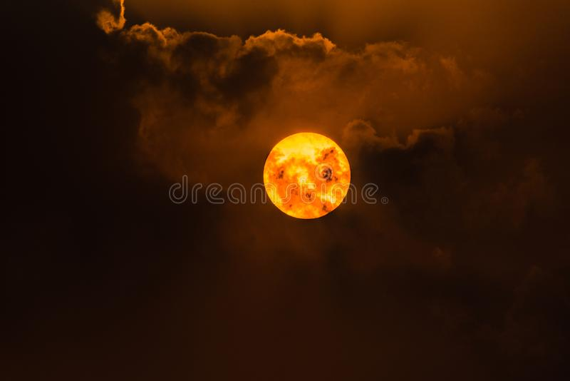 The Sun and clouds. Hide and Seek between cloiuds and the sun royalty free stock photo