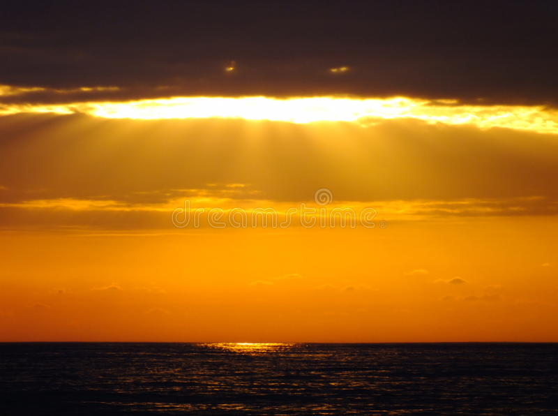 Sun clouds and sea stock images