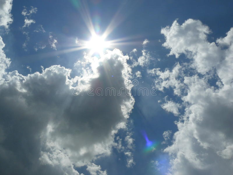 Sun with clouds stock photography