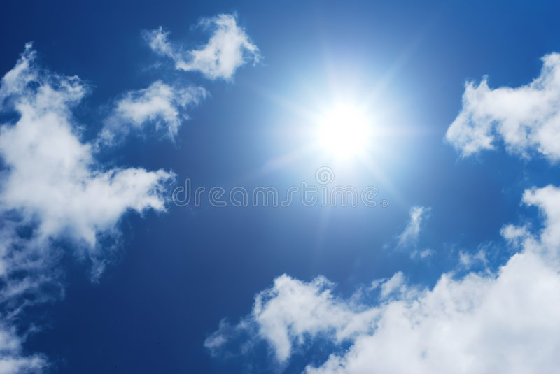 Sun in cloudy sky. Sun shinning in a blue and white sky royalty free stock images