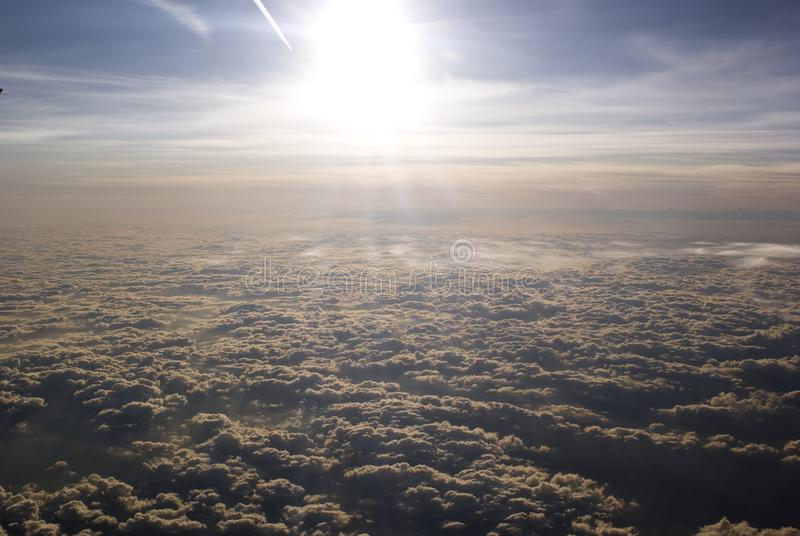 Sun in cloudy sky, plane view stock photo