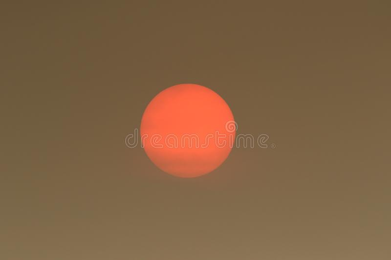 The Sun colour in the Uk was due to a weather phenomenon, Saharan dust, blown in by ex-hurricane Ophelia and also from debris, cau. Sun colour in the Uk was due royalty free stock photo