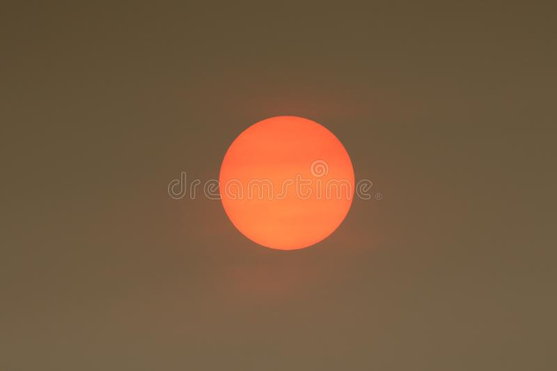 The Sun colour in the Uk was due to a weather phenomenon, Saharan dust, blown in by ex-hurricane Ophelia and also from debris, cau. Sun colour in the Uk was due royalty free stock photography