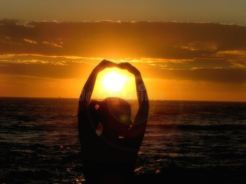 Sun Dancer. A close-up view of a young woman dancing at sunset stock photos