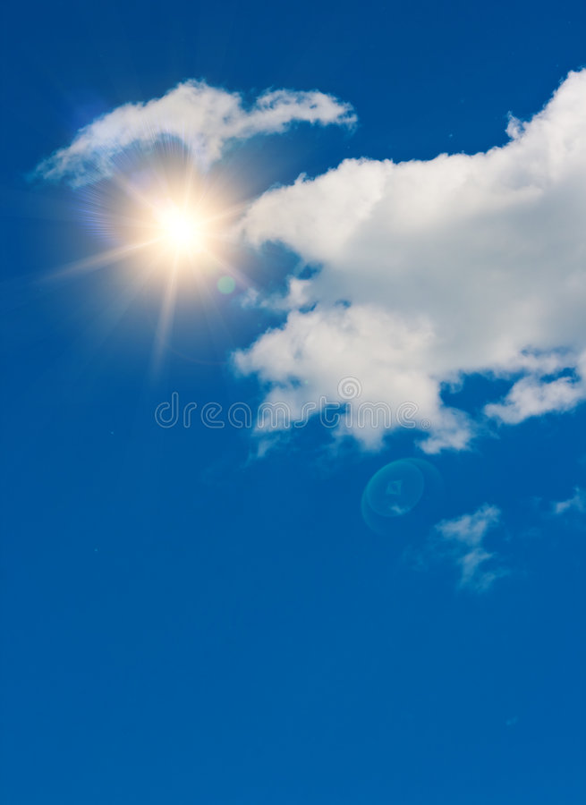 Sun in the dark blue sky with clouds royalty free stock photos