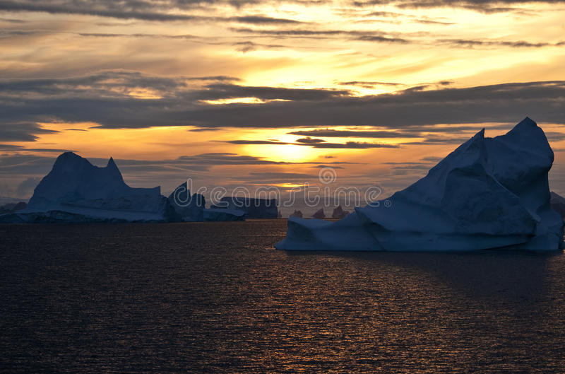 Sun de minuit - le Groenland image stock
