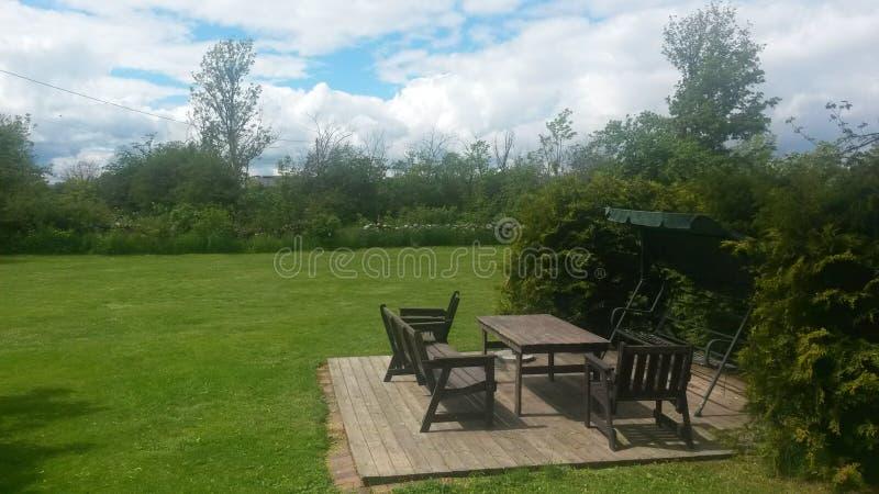 Sun deck in lawn garden stock image