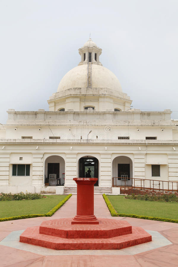 Sun Dial and the administrative building of IIT Roorkee. ROORKEE, INDIA - JULY 03: Sun Dial and the interior of administrative building of IIT Roorkee royalty free stock photography