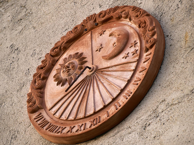 Sun dial solar wall clock royalty free stock image