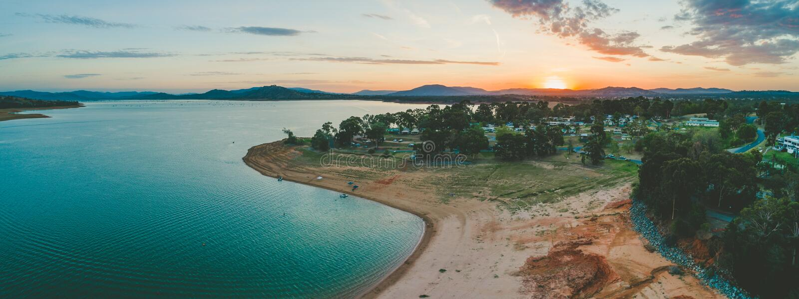 Sun disappearing behind mountains near Lake Hume Village. royalty free stock photos