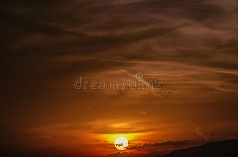 Sun disc in the sky, warm late autumn evening over the mountainous terrain in Armenia royalty free stock photography