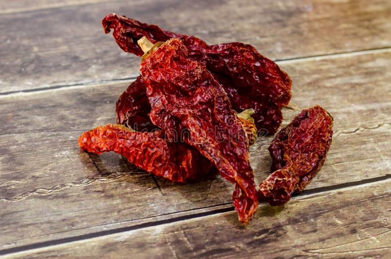 Sun dried red pepper natural. Sun-dried red bell pepper, dried bitter local natural with methods stock photography