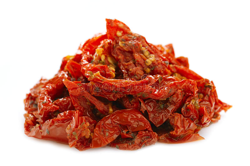 Sun-dried tomatoes with olive oil royalty free stock photos