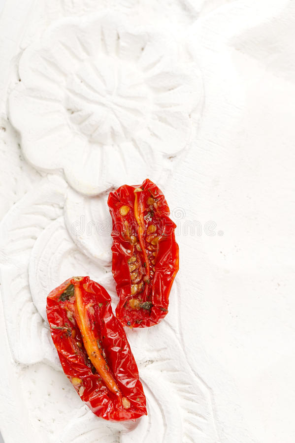 Sun-dried tomatoes with olive oil stock image