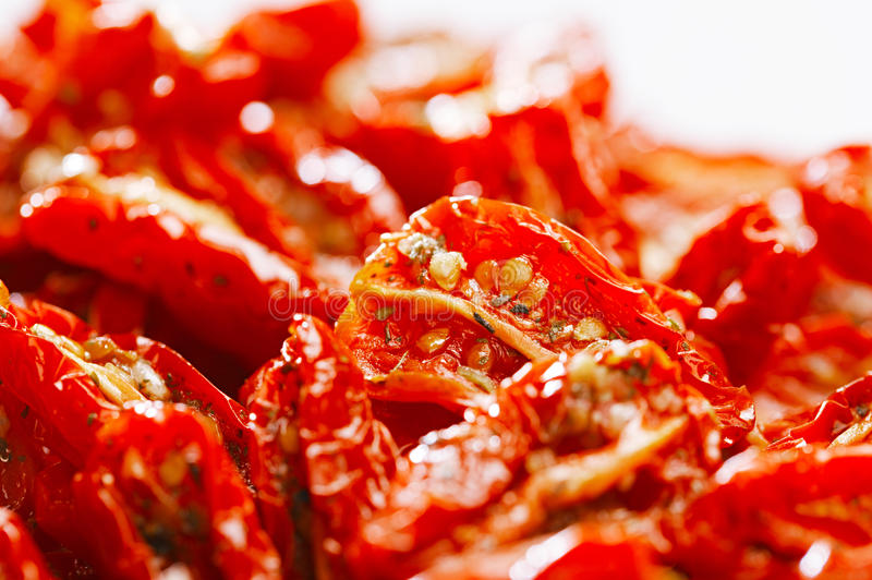 Sun-dried tomatoes with olive oil, background stock photo