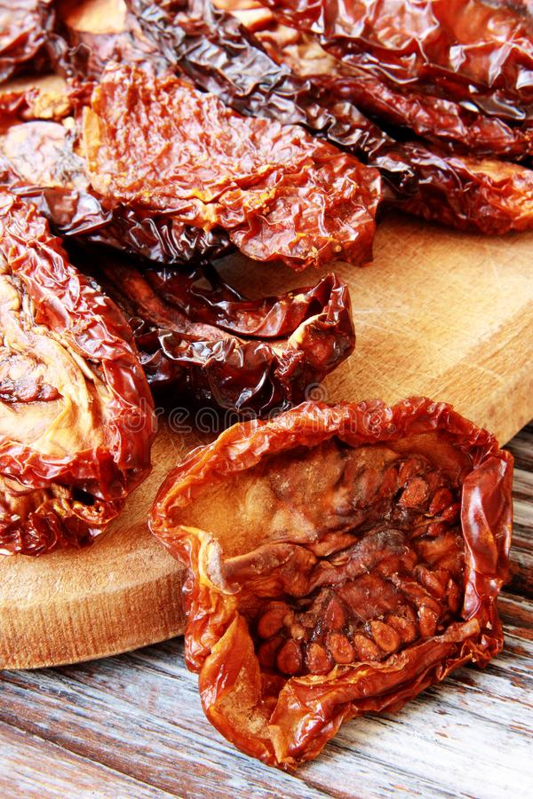 Sun dried tomatoes . selective focus stock photos