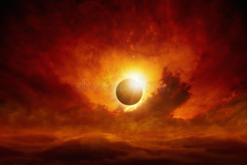 Sun eclipse. Dramatic apocalyptic background - sun eclipse, dark red sky, glowing horizon