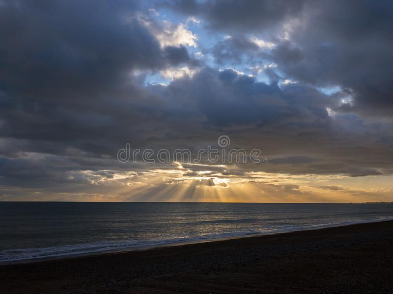 Sun through English clouds over the channel royalty free stock images