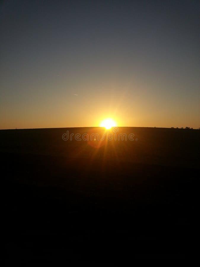 Sun está subiendo imagen de archivo