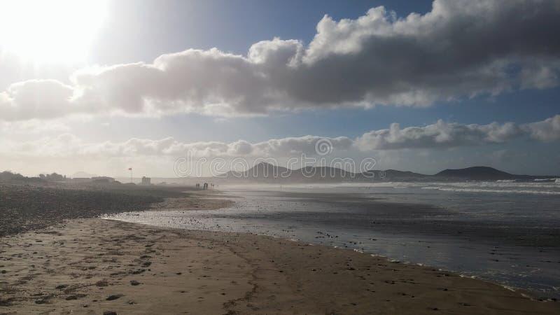 Sun and Famara beach. The sun shines on the beach of Famara Lanzarote, Spain stock image