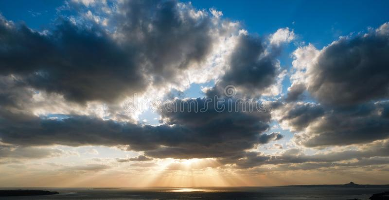 The sun fell behind the clouds during the evening..The sun rays penetrate the clouds in the morning stock photography