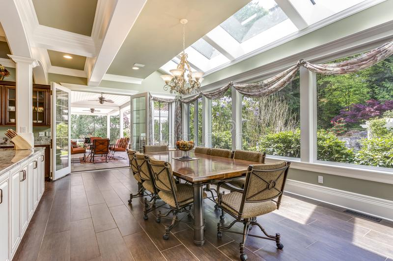 Sun filled dining area of a large country home. royalty free stock image