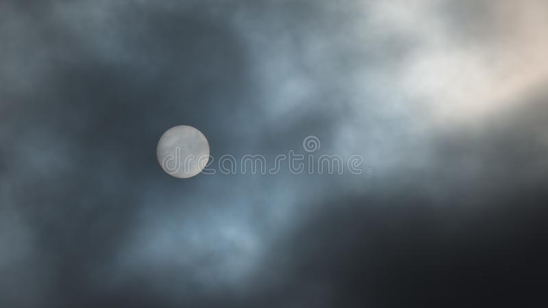Sun filtered by dark clouds in the sky - looks like the moon but you can see sun spots - blue skies visible - as seen from Minneso royalty free stock image
