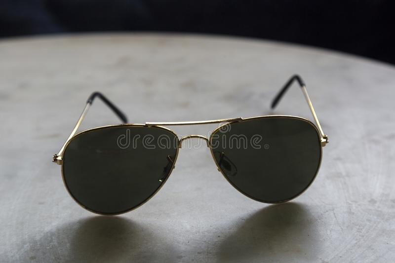 Sun glasses on the table royalty free stock images