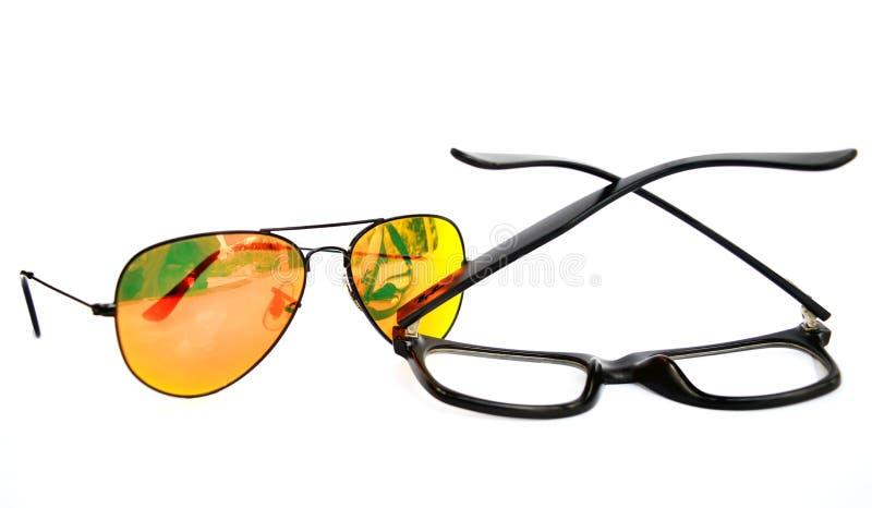 Sun Glasses vs eye glasses royalty free stock image
