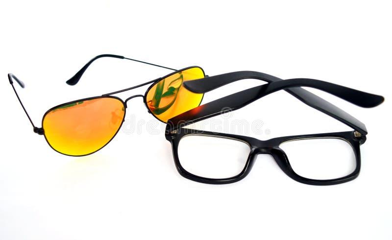 Sun Glasses vs eye glasses stock image