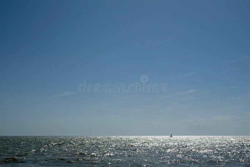 Sun glinting off the ocean surface stock photo