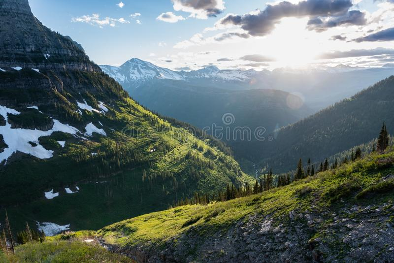 Sun Glows Over Green Montana Mountains. Near Logan Pass royalty free stock image
