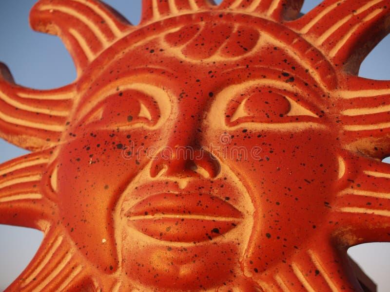 Sun God in the Sky. Mezo-American sun god against the sky royalty free stock photo