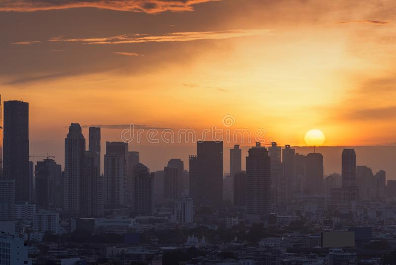 The sun goes down at Bangkok city, sunset time background stock images