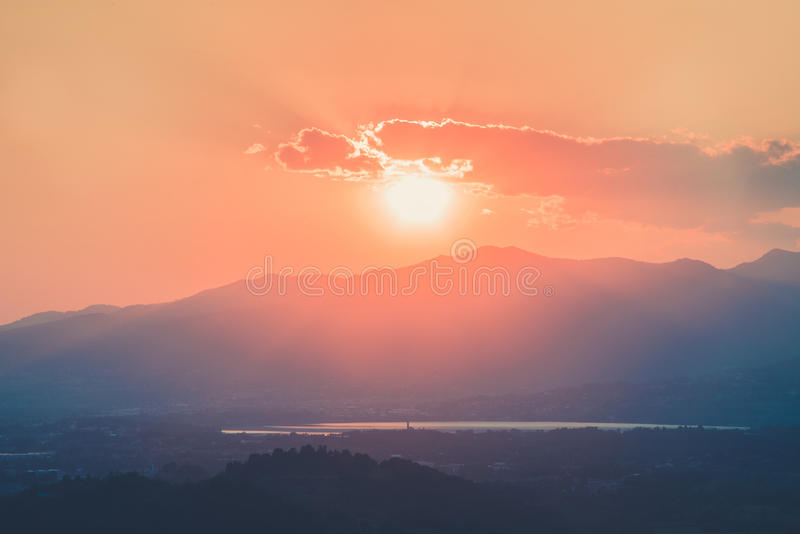 Sun goes down behind the mountains. Sun goes down behind the mountain stock photo