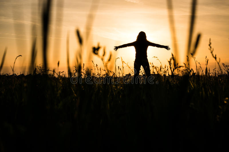 The sun goes down stock images
