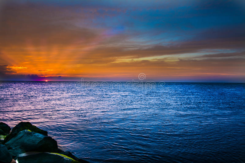 Sun going behind horizon royalty free stock photography