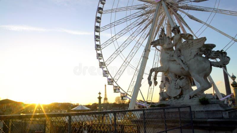 Sun going down in Paris, big wheel in Tuileries Garden, Eiffel Tower in distance stock images