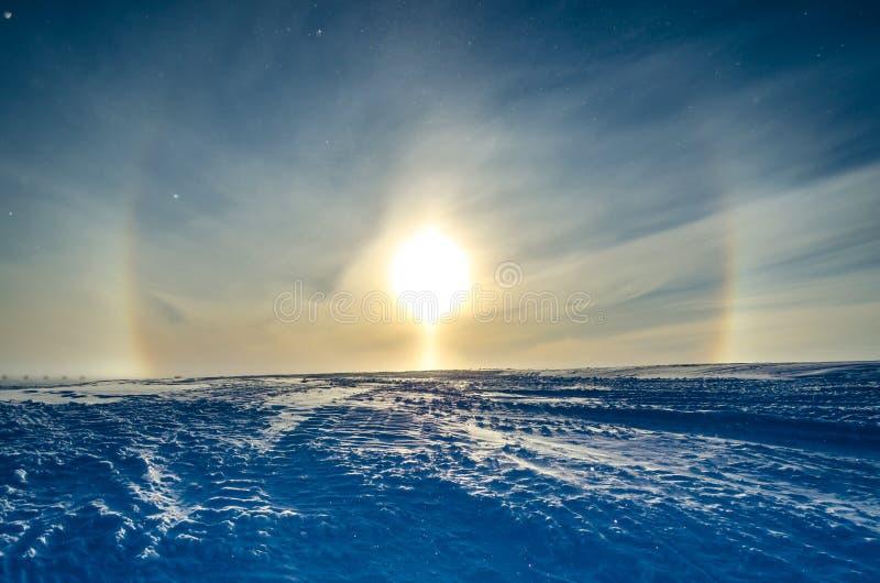Sun Halo above ice shelf. Antarctica. Sun Halo and Sun pillar. Halley Bay Ice Shelf, Antarctica royalty free stock image