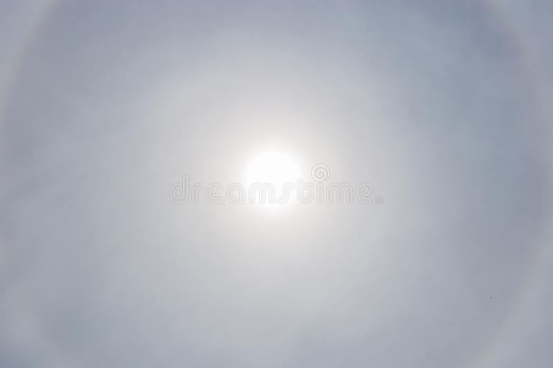 The sun halo with cloudy sky in background, natural phenomenon. The sun halo with cloudy sky in background, natural phenomenon concept stock image