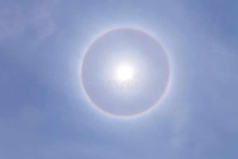 Stunning sun halo with deep blue sky on sunny day royalty free stock photography