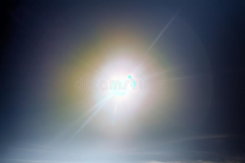 Sun halo, mock sun. Solar halo - optical phenomenon, refracted by ice crystals light. Parhelic circle. Crowns is bright hazy ring on celestial sphere around stock photo