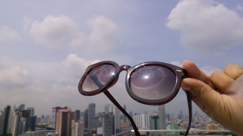 Sun halo optical phenomenon reflect on sunglasses. Bangkok Thailand royalty free stock images