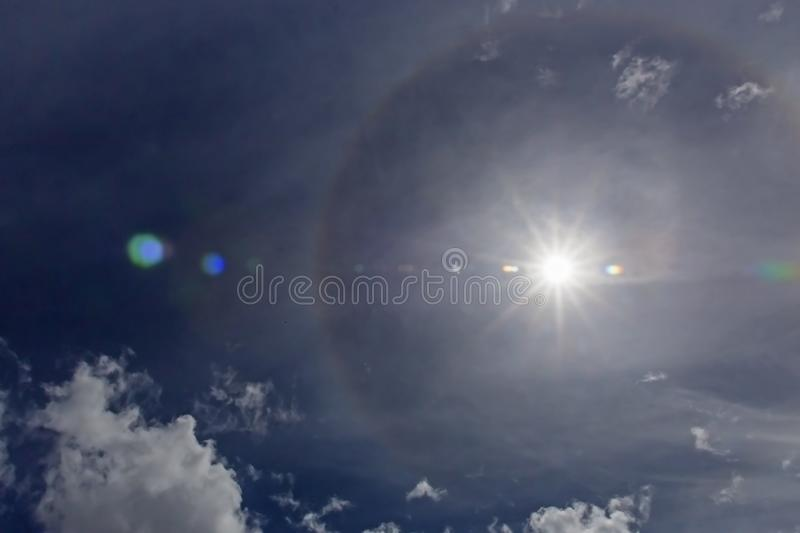 Sun Halo Phenomena. Halos are atmospheric phenomena created by light which is reflected or refracted by ice crystals in the atmosphere. Halos can have many forms stock photos