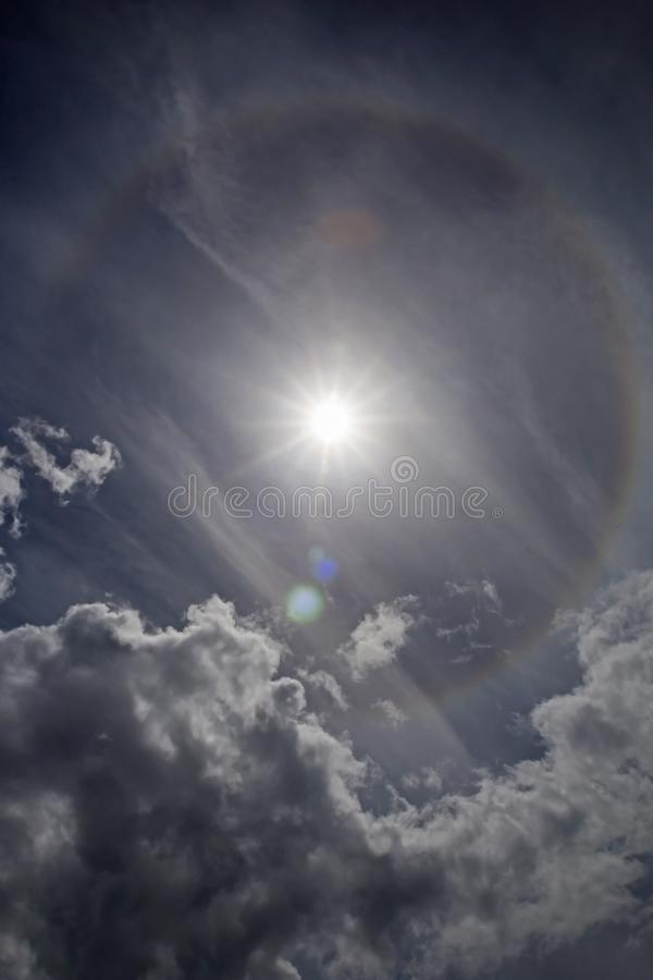 Sun Halo Phenomena. Halos are atmospheric phenomena created by light which is reflected or refracted by ice crystals in the atmosphere. Halos can have many forms royalty free stock image