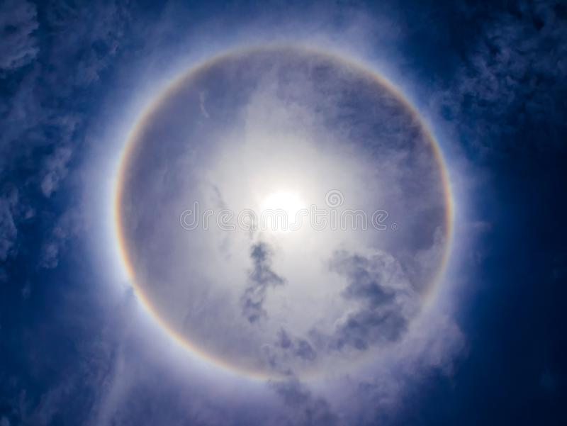 Sun halo phenomenon on blue sky.  royalty free stock photos